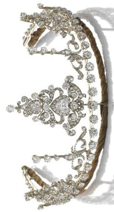 DIAMOND NECKLACE/ TIARA, CIRCA 1890 The diamond necklace designed as a graduated line of circular-cut diamonds to knife-edge linking, accompanied by seven jewels, the largest of acanthus and scroll design, articulated and set with circular-, single-cut, rose and triangular diamonds, the remaining six jewels of similar design, mounted in silver and gold. Accompanied by several fittings including a tiara frame, brooch, hair comb and pair of earrings, later fitted case. by ella_church