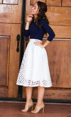 Modest punched mid length high waist skirt with unique elastic waist and full lining in white