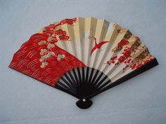 A Sensu folding fan with black-lacquered handles features popular motifs such as pine, bamboo, Japanese apricot and a crane. Please choose from 2 pattern options as below - see 'Other Images.'  (http://www.teaceremonyutensils.com/product/167)
