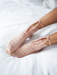Serenade Wrap Sock | Made from a stretchy fabrication, these socks feature laser cut detailing and a cute tie accent that wraps around the ankle.
