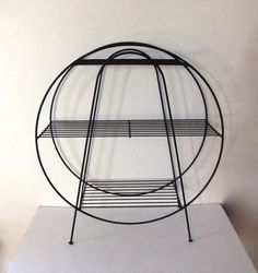 A fabulous vintage black metal plant stand. Round in shape it is perfect to hold your favorite plants, display your favorite collection or hold