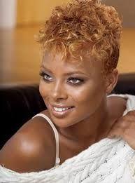 Supermodel loving her natural golden hair.