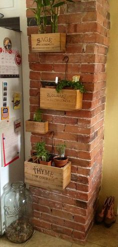 Herbs Gardening What I like - different size planter boxes on the brick. I think I would have a brick wall just so I could do this. Maybe other side could be blackboard paint or kraft roll shopping list Herb Wall, Deco Nature, Deco Floral, Planter Boxes, Herb Planters, Wall Planters, Sweet Home, Home And Garden, House Design