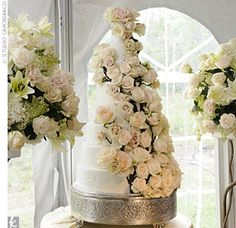 burlap large roses  | ... Mike's towering, eight-tiered, white cake was covered with roses