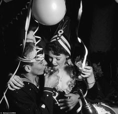 Lovebirds A United States Navy man on leave from his ship lifts an elbow and drinks a toast with his girlfriend to peace and more lasting reunions in the new year in 1941