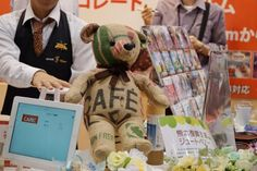 Coffee Bag Jute Bear  The Jute Bear at the CAFEC booth is a handmade piece of work designed to be both durable and unique to the touch, with proceeds from each sale going towards support for restoration after the Kumamoto earthquake.  Cute. Caffeinated. Coffee-style.