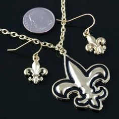 NEW! SPECIAL PURCHASE ON THIS BEAUTIFUL FLEUR DE LIS / NEW ORLEANS SAINTS GOLD NECKLACE AND EARRING SET . INCLUDES CHAIN.
