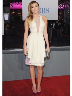Miley Cyrus in a pale yellow David Koma dress. literally one of my favorite dresses I've seen her wear. obsessed.