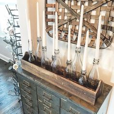 do this on dining rm. table add greens and pinecones around bottles. use wine bottles?