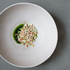 Simple yet hypnotizing. Raw mackerel and frozen sea textures by chef @evenramsvik of the one michelin-starred Ylajali from Oslo, Norway. See more of his food on http://theartofplating.com #TheArtOfPlating