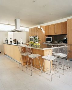 In This Contemporary Los Angeles Home Owners Added Sleek Yet Comfortable Bar Stools For The Family Meals That Often Take Place At Expansive Kitchen