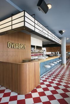 In a country already heaving with superb multi-ethnic cuisines, it may seem a little incongruous that an all-American diner like Overeasy could make such a lasting impression on the local Singaporean palate. To mark eight years of thick milkshakes, ch. Restaurant Counter, Diner Restaurant, Bayside Restaurant, Cheese Restaurant, Design Café, Cafe Design, Sport Bar Design, Design Ideas, Commercial Design