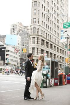 bride and groom outside in nyc http://www.itgirlweddings.com/blog/glamorous-nyc-elopement