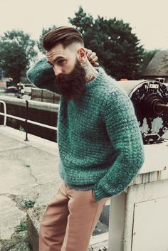 How many tattooed, bearded bad boys can pull off a green sweater? Ricki fuckin Hall, that's how many lol