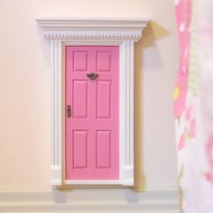 Lil Fairy Door - Watermelon Pink: Invite the Fairies into your home. Once your Fairy Door is attached, the fairies will know how to use it to come in and out.  They only come out at night, and are sometimes known to exchange notes and gifts with well behaved children. #alltotstreasures #lilfairydoor #watermelonpink #woodentoys #fairyworld #fairies #fairydoor