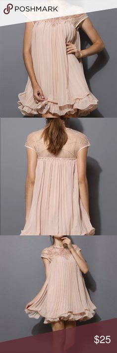Embroidery Plated Chiffon Short Party Dress Chiffon pleated dress with a skirts that flows out like a lotus flower can be a playful party dress. It also comes in a beaded neckline. Dresses Mini