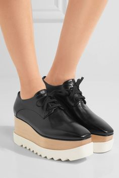 Wood and off-white rubber heel measures 90mm/ 3.5 inches with a 50mm/ 2 inches platform Black faux glossed-leather Lace-up front Made in Italy