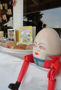 """The Humpty Dumpty in this thumbnail is hella creepy, but I like a lot of the rest of this post like the mini """"books"""" on the banner and the themed food. Check comments for a whole board with more ideas Storybook Party, Storybook Baby Shower, Baby Shower Themes, Baby Boy Shower, Shower Ideas, Baby Theme, Baby Showers, Book Shower, Humpty Dumpty"""