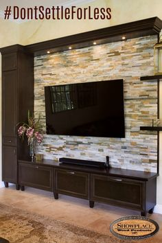 Door style: Arlington   |  Species: maple  |  Finish: Espresso  Dealer: KabCo Kitchens, Pembroke Pines, FL  The adjacent family room was also enhanced with Showplace maple Espresso. This creative asymmetrical entertainment unit soars to 140 inches tall, and features custom Showplace floating shelves on the right. The stone ledger tile creates an impressive backdrop for the television. Once again, the flexibility of Showplace rises to the challenge.