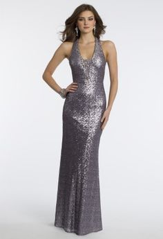 Disembark in the realm of ravishing glamour in this top to bottom all sequin party dress designed by Ignite. A halter style dress with a plunging neckline and an open lace-up back shows off your body in the classiest of ways.  ��All sequin long dress��Halter style dress��Beaded plunge neckline ��Lace-up open back