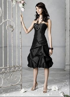 short black bridesmaid dress-- that's HOT. The bride would really have to make sure she stepped up her game, to not be outshined. This whole style is AWESOME. Would be great for wedding colors white and black. Or black anything.