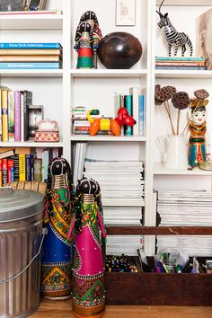 AphroChic: 6 Ways To Display Cultural Artifacts On Your Bookshelf White Shelving Unit, White Shelves, Small Space Living, Small Spaces, Bookshelf Inspiration, Wooden Tool Boxes, Cultural Artifact, African Dolls, Bookshelf Styling