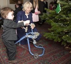 Tree decorating and sausages for Camilla and her young guests