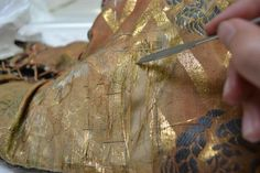 Conservation treatment of silk damask sleeves | Victoria and Albert Museum