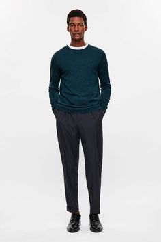 COS image 1 of Relaxed turn-up trousers in Navy