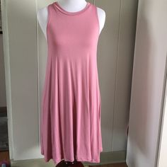 Dusty pink sleeveless tank dress Super cute & comfortable sleeveless tank dress. Dusty pink color, perfect for upcoming Spring time  made in the USA. Made from 96% rayon & 4% spandex. Runs true to size. April Spirit Dresses Midi