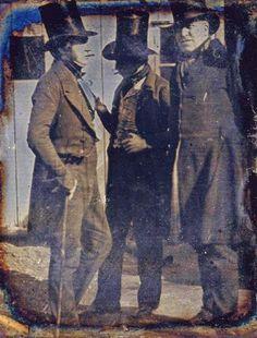 Daguerreotype portrait of three unidentified men wearing stove pipe hats, c. 1850.
