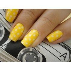 yellow and white polka dot nail art