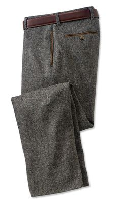 "Get the distinctive salt-and-pepper look and warmth of robust, 12.5-oz. pure wool Donegal tweed in these plain front pants. Our master tailors incorporate all the details you require, including full lining for a comfortable fit, along with faux-leather trim on the side-seam pockets and button-through back pockets. Plain front pants in pure wool tweed. Belt not included. Polyester/cotton lining. Dry clean. Imported. <br />Even waist sizes: 32-46. Cuffed up to 34"" or plain finished up to 35""…"