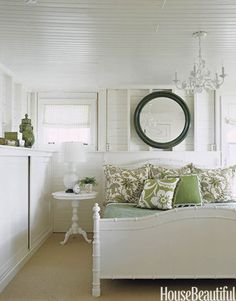 White bedroom with a touch of green. Designer: Tom Stringer. Photo: Ngoc Minh Ngo. housebeautiful.com #greenbedroom #softgreen