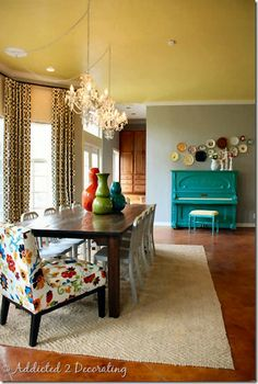 Love the colors. Ceiling painted to add warmth. Chandelier redirected over table