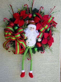 Welcome to Designerwreaths2013!!!    Spectacular Christmas Wreath and Swag!!! A very long legged Santa has been placed in the center of the