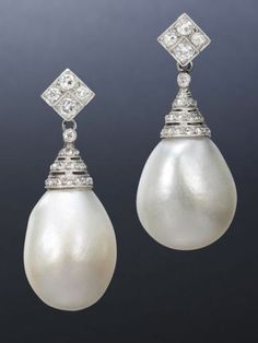 A pair of natural pearl and diamond earrings  Each natural pearl with a pierced cap set with rose-cut diamonds, to a lozenge-shaped surmount set with brilliant-cut diamonds, length 3.5cm