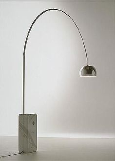 Arco lamp by Achille Castiglioni and Pier Giacomo Castiglioni for Flos : functional elegance sums up this fantastic floor lamp designed by Achille Castiglioni for Flos in 1962.