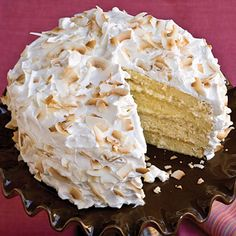Four-Layer Coconut Cake | Layer upon layer of tropical coconut and soft whipped cream topping make this a year-round favorite indulgence.