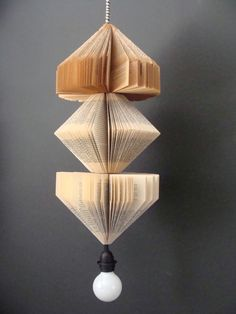 Ugly cord hidden by folded books.