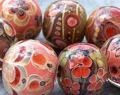 Handmade glass beads, pinks, flowers, intricate detail, gorgeous.