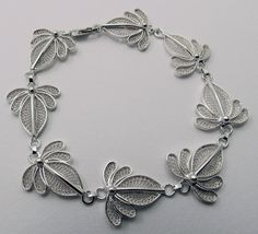 filigree jewelry designs | Sentry Air is familiar with the Sylla's work because he and his wife ...