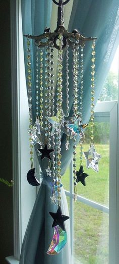 Bohemian Goth Crystal Stars and Moons Suncatcher cum windchime by sheriscrystals Deco Pastel, Deco Floral, Combs La Ville, Dreams Catcher, Sun Catchers, Diy And Crafts, Arts And Crafts, Deco Boheme, Home And Deco