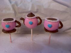 Tea pot & tea cups cake pops - These were just some cake pops that I was trying out for fun. They are dipped in chocolate and I used tootsie rolls for the handles and saucers. I made the beads with the bead maker.
