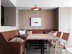 EN Apartment — Marc Merckx Interiors brown leather banquette, oak table and wall paneling