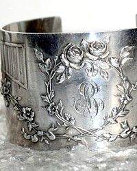 Jewelry Designer Karen Lindner takes antique napkin rings to create her exquisite classic~modern one of a kind cuffs.  This exquisite Silver Cuff Bracelet was created in solid Sterling Silver, circa 1891. Hand applied Rose detailing was done by a master silversmith in Paris, France  in the 19th century, details include Garlands and a script monogram LB.