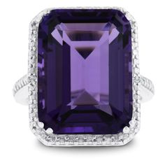 This emerald shape amethyst and diamond ring features an 11 carat emerald shape amethyst. It is surrounded with 2 diamonds in J-K color, I1-I2 clarity at 0.01ct total diamond weight.