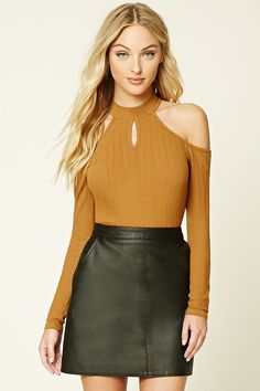 A ribbed knit top featuring open shoulders, a high neckline with a keyhole cutout, and long sleeves.