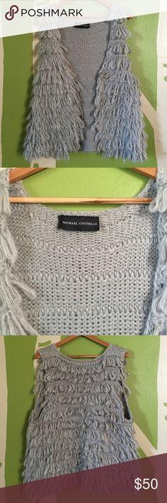 Michael Costello 100% acrylic knit vest, size L Michael Costello 100% acrylic knit vest, size L.  Project runway designer, Michael Costello, unique vest! Michael Costello Sweaters