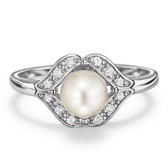 """The pearl is June's birthstone which symbolizes affection, happiness, and generosity.Sterling silver genuine Freshwater Pearl ring in a CZ embellished diamond shaped setting. Imported.STERLING SILVER is the standard for fine silver jewelry in the world over. Only Sterling Silver can be stamped with a """"fineness mark"""" of .925 indicating its high quality.Sterling Silver Birthstone Ring Collection: June"""